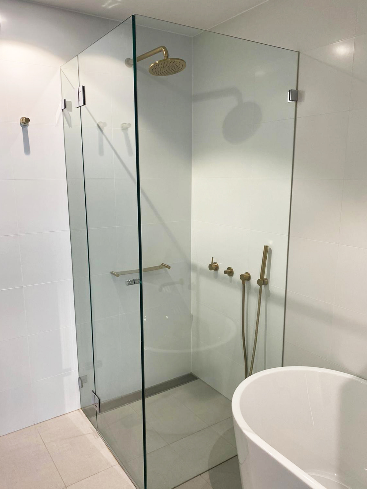 Semi-Frameless Shower Screen by Instyle Wardrobes